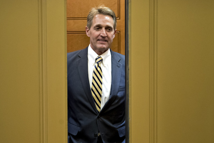 Flake gets on an elevator at the Capitol. (Andrew Harrer/Bloomberg News)