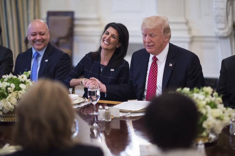 Nikki Haley laughs as Trump makes a joke during a lunch with ambassadors on Monday. (Jabin Botsford/The Washington Post)/p