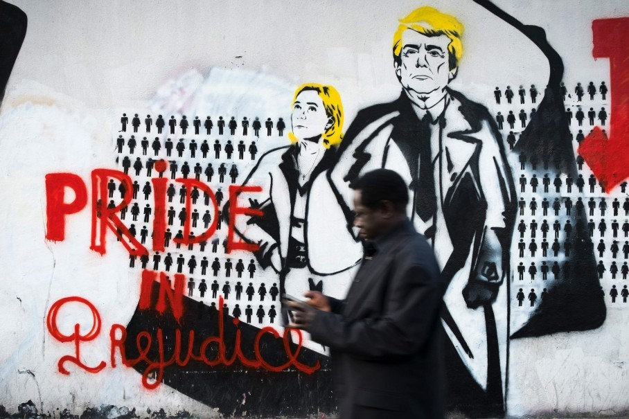 Street Graffiti In Paris Depicts Le Pen And Trump With The Caption Pride In Prejudice Joel Saget Getty