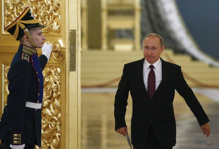 Russia President Vladimir Putin walks past an honor guard as he attends a session of the Council for Civil Society and Human Rights at the Kremlin in Moscow yesterday. (Sergei Karpukhim/EPA/Pool)</p>