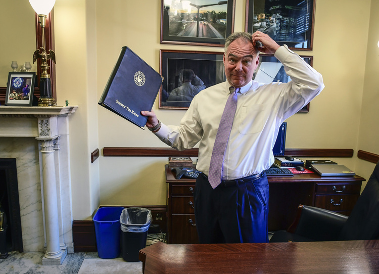Tim Kaine works in his Senate office yesterday. (Bill O'Leary/The Washington Post)</p>