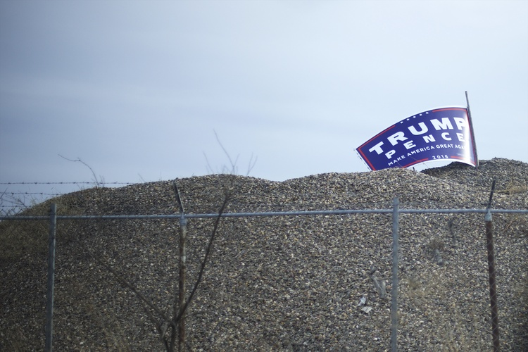 "A Trump campaign sign remains atop a pile of gravel in Harrisburg, Penn, where Foxconn said in 2013 it'd build a $30 million factory. It didn't happen, but now more promises are being made. ""Foxconn is going to spend a tremendous amount of money on building a massive plant,"" Trump said, ""and probably more than one."" (Mark Makela/For The Washington Post)/p"