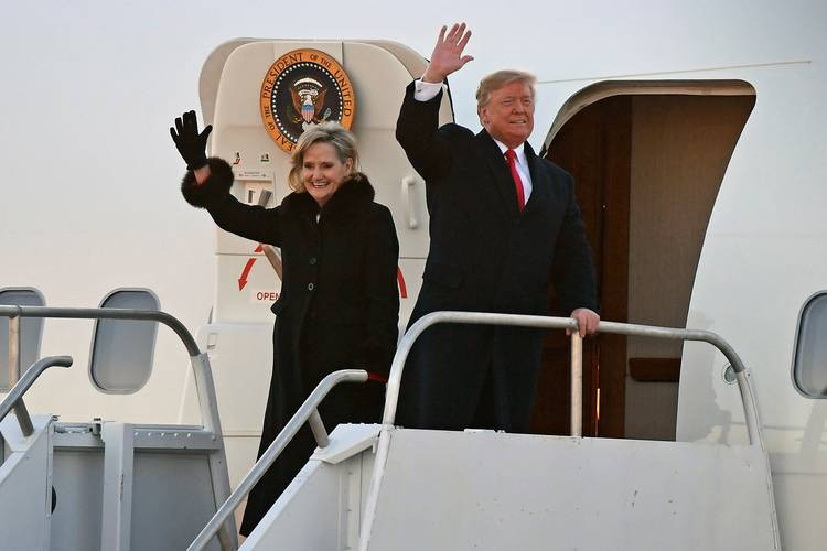 President Trump and Sen. Cindy Hyde-Smith (R-Miss.) wave to supporters after arriving for a rally in Tupelo, Miss. (Thomas Graning/AP)