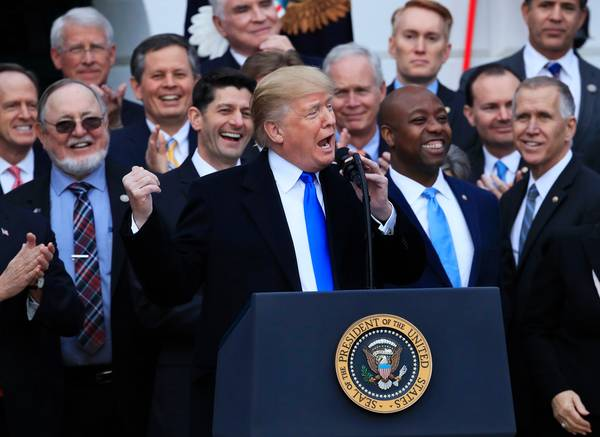 President&nbsp;Trump celebrates the passage of the Republican tax-cut&nbsp;bill at the&nbsp;White House on Dec. 20. (Manuel Balce Ceneta/Associated Press)</p>