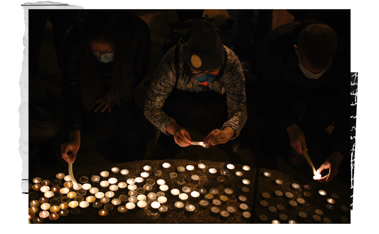 Mourners light candles at a vigil in Washington, D.C., following the attacks in Georgia. (Photo by Astrid Riecken For The Washington Post)