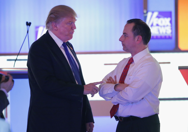 Trump confers with RNC Chairman Reince Priebus. (Photo by Chip Somodevilla/Getty Images)</p>